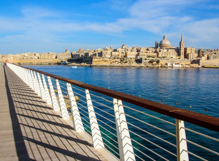 A wooden walkway in Tigne and Valletta on the other side.